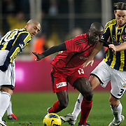 Fenerbahce's Reto Pirmin Ziegler (R), Alexsandro de Souza (L) and Gaziantepspor's Dany Nounkeu (C) during their Turkish superleague soccer match Fenerbahce between Gaziantepspor at the Sukru Saracaoglu stadium in Istanbul Turkey on Monday09 January 2011. Photo by TURKPIX