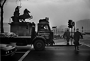 Man crossing Victoria embankment in front of equestrian statue The statue sits atop a large stone plinth over the southern exit to Westminster Underground station and at the head of the abutment steps of Westminster Bridge. Coming and Going is a project commissioned by the Museum of London for photographer Barry Lewis in 1976 to document the transport system as it is used by passengers and commuters using public transport by trains, tubes and buses in London, UK.
