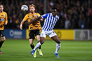 Cambridge United midfielder James Brophy  (7)  and Sheffield Wednesday midfielder Fisayo Dele-Bashiru  (17)  battles for possession during the EFL Sky Bet League 1 match between Cambridge United and Sheffield Wednesday at the Abbey Stadium, Cambridge, England on 19 October 2021.