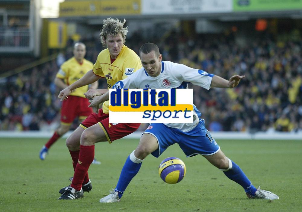 Photo: Marc Atkins.<br /> Watford v Middlesbrough. The Barclays Premiership. 04/11/2006. Darius Henderson (L) of Watford & Emanuel Pogatetz of Boro in action.
