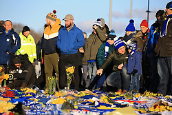 Fans place flowers and t-shirts with messages in tribute of Emiliano Sala during the Premier League match at the Cardiff City Stadium.