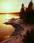 Winter sunset over Lake Superior near the mouth of Cascade River, Cascade River State Park, Minnesota.