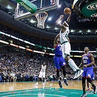 08 December 2012: Boston Celtics power forward Chris Wilcox (44) dunks the ball off the alley hoop pass from Boston Celtics point guard Rajon Rondo (9) during the Boston Celtics 92-79 victory over the Philadelphia 76ers at the TD Garden, Boston, Massachusetts, USA.
