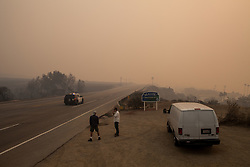 November 10, 2018 - Malibu, California - Smoke from the Woolsey Fire covers the Pacific Coast Highway in Malibu, California. The Woolsey fire doubled in size overnight with 70,000 acres burned forcing nearly 95,000 residents to evacuate their homes in Los Angeles and Ventura counties as of Saturday morning according to Cal Fire. (Credit Image: © Joel Angel Juarez/ZUMA Wire)