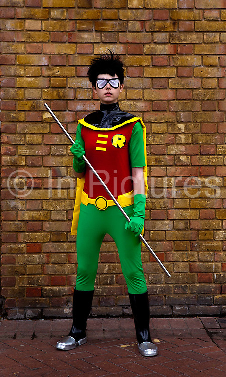 Christel Dee as Robin from Teen Titans attending the London Film and Comic Con LFCC is a convention held annually in London that focuses on films, cult television and comics. The convention holds a large dealers hall selling movie, comic and science fiction related memorabiliaand original film props, along with free guest talks, professional photoshoots, autograph sessions, displays. Many of the visitors / attendeesarrive dressed up as their favourite comic and sci-fi characters in the most outlandish costumes which draws from the award-winning formula of innovative gameplay..Teen Titans is based on the DC Comics superhero team, and revolves around main team members Robin (the leader), Raven, Starfire, Beast Boy, and Cyborg. While it is an action cartoon, the series is also character-driven, with a focus on the main characters' struggles with being teenage superheroes, their mutual friendships, and their limitations
