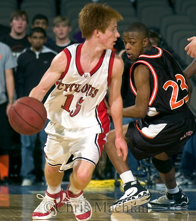 2/11/06 -- Omaha, Ne.Harlan's A.J. Arkfeld drives the ball past Sioux City East's Davion Gentry at The Omaha Shootout, a High School Basketball tournament featuring some of the best prospects at the Qwest Center Omaha...(Photo by Chris Machian/Prarie Pixel Group).