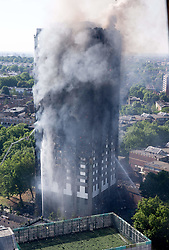 June 14, 2017 - London, United Kingdom - Emergency services attend a major fire at Glenfall Tower in Latimer road.Police say there have been several casualties. (Credit Image: © Mark Thomas/i-Images via ZUMA Press)