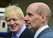 © Licensed to London News Pictures. 14/05/2013. London, UK (Left to right) Boris Johnson and Lord Adonis, Chairman of the Crossrail 2 Task Force for London First. The Mayor of London, Boris Johnson, leads a short walkabout around Wimbledon High Street to meet local people as he helps launch a public consultation on proposed routes for Crossrail 2. Today 14th May 2013. Photo credit : Stephen Simpson/LNP