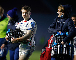 Ioan Lloyd of Bristol Bears helps a member of staff carry the water bottles back to the changing room after the game  - Mandatory by-line: Matt Impey/JMP - 26/12/2020 - RUGBY - Twickenham Stoop - London, England - Harlequins v Bristol Bears - Gallagher Premiership Rugby