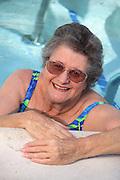 Senior Woman Enjoying Exercise At The Pool