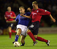 Photo: Richard Lane.<br />Leicester City v Crewe Alexandra. Carling Cup. 23/09/2003.<br />Dean Ashton is challenged by James Scowcroft.