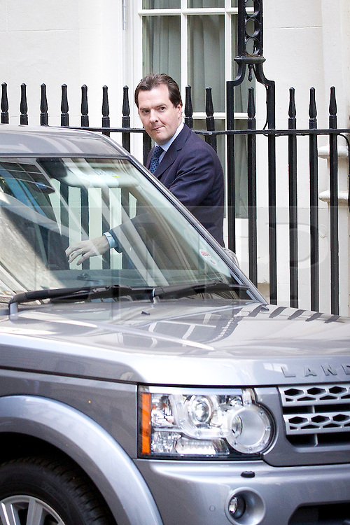 """© Licensed to London News Pictures. 29/08/2013. London, UK. Chancellor of the Exchequer George Osborne leaves a meeting of the British cabinet on Downing Street in London today (29/08/2013) as a recalled British Parliament prepares to debate the possibility of """"direct"""" military action over recent reports an alleged chemical weapons attack in Syria. Photo credit: Matt Cetti-Roberts/LNP"""