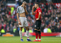 Liverpool's Fabinho (left) and Manchester United's Andreas Pereira show their dejection after the final whistle