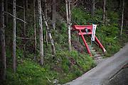 A broken shrine gate is seen in Minamisanriku town.