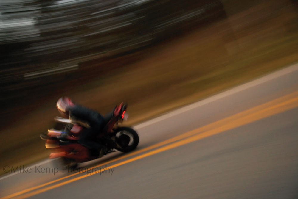 A panned photo of a motorcyclist, used to illustrate the best area motorcycle roads for 501 Life Magazine.