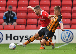 Hull City's Markus Henriksen is tackled