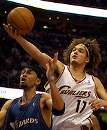PHOTO BY DAVID RICHARD.Anderson Varejao, right, of Cleveland reaches for an offensive rebound against Jared Jeffries of Washington yesterday.