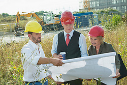 Architect and building owners on site inspection