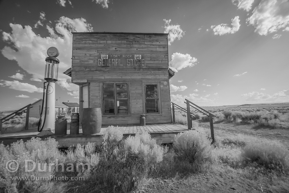 Preserved general store with gas pump in Fort Rock, Oregon. In 1988 the Fort Rock Valley Historical Society opened the Fort Rock Homestead Village Museum which preserves and protects homestead-era structures. The buildings were moved from their original locations to the museum site just west of the town of Fort Rock., Oregon. © Michael Durham