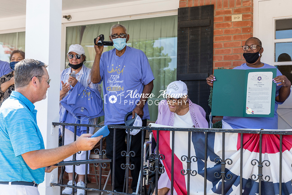 Oklahoma State Senator Chuck Hall, left, of district 20 greets and presents Ethel M. Bowens, center, with gifts during a celebration parade in Guthrie, Okla. outside of the Golden Age Nursing Home in honor of her 112th birthday and being named the oldest living Oklahoman on Saturday, Aug. 21, 2021. Photo by Alonzo J. Adams.