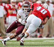 Sept 15, 2012; Dallas, TX, USA; Texas A&M Aggies defensive back Tramain Jacobs (7) tackles Southern Methodist Mustangs running back Zach Line (48) during the second quarter at Gerald J. Ford Stadium. Mandatory Credit: Thomas Campbell-US PRESSWIRE