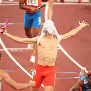 TOKYO, JAPAN - JULY 31: Poland win the 4 x 400m Relay Mixed as Jakub Krzewina of Poland running the anchor leg, celebrates after crossing the line for the gold medal during the Athletics competition at the Olympic Stadium  at the Tokyo 2020 Summer Olympic Games on July 31, 2021 in Tokyo, Japan. (Photo by Tim Clayton/Corbis via Getty Images)