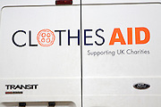 Clothes Aid charity sign on white Transit van