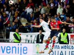 Andraz Kirm of Slovenia vs Omar Elabdellaoui of Norway during the FIFA World Cup 2014 Group E qualification match between Slovenia and Norway on October 11, 2013 in Stadium Ljudski vrt, Maribor, Slovenia. (Photo by Urban Urbanc / Sportida)