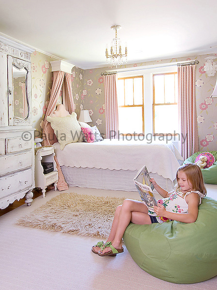 Child's bedroom interior with pink and green color tones and girl model