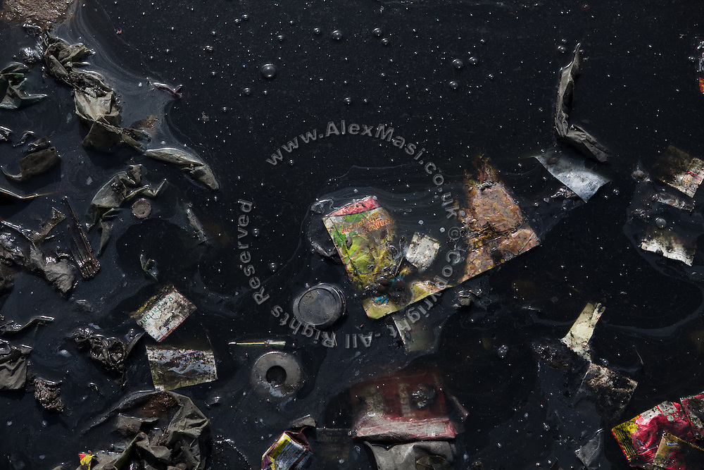 Garbage has been thrown in the heavily polluted and semi-dry Yamuna River next to the Taj Mahal, in Agra.