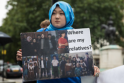 London, UK. 5th August, 2021. A member of the Uyghur community joins activists from Uyghur Solidarity Campaign UK and other supporting groups protesting opposite the Chinese embassy in support of the Uyghur people's struggle for freedom. Activists highlighted the Chinese government's persecution and forced assimilation of Uyghurs, Kazakhs and other indigenous people in East Turkestan and Xinjiang and called for them to have the right to determine their own futures through a democratic process.