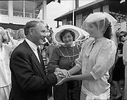 "Best Dressed Lady at Phoenix Park Races.1984..11.08.1984..08.11.1984.11th August 1984..A competition,sponsored by V'Soske Joyce,was held at the Phoenix Park Racecourse,Dublin.The prize of a hand tufted rug was awarded to the ""Best Dressed Lady"" on Ladies Day at the racecourse. The eventual winner was Brianne Leary from Los Angeles,California..Image of the Director of the sponsors, V'Soske Joyce ltd,Oughterard,Galway, Mr Michael Dixon and the Best Dressed Lady,Ms Brianne Leary (right) after the decision was reached. Unfortunatly the lady in the centre is not known to us,If you know who she is why not contact us at irishphotoarchive@gmail.com ."