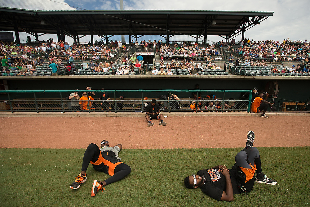 Augusta GreenJackets players lay on the field and prepare to watch the total solar eclipse. <br /> Total Solar Eclipse: Augusta GreenJackets vs. Charleston RiverDogs at Joseph P. Riley Park in Charleston, S.C. on Monday, Aug. 21, 2017.  <br /> Zach Bland/Charleston RiverDogs