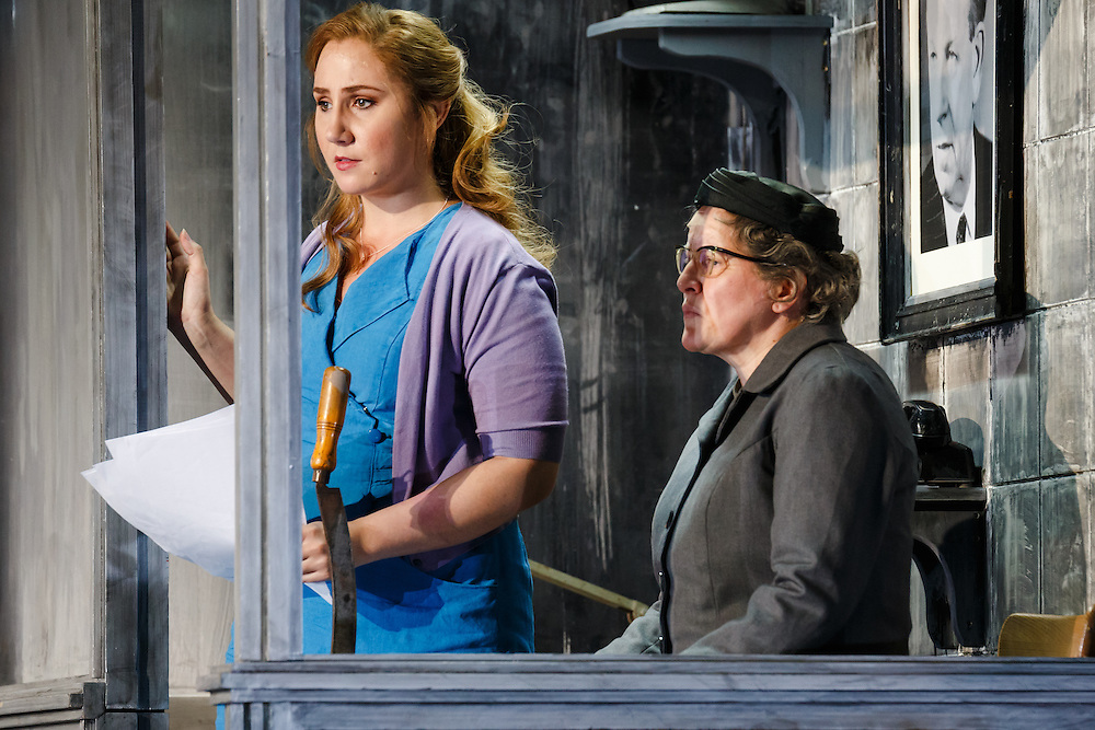 """LONDON, UK, 21 June, 2016. Left to right: Laura Wilde (as Jenufa) and Valerie Reid (as Grandmother Buryja) rehearse for the revival of director David Alden's production of Janacek's opera """"Jenufa"""" at the London Coliseum for the English National Opera. The production opens on 23 June. Photo credit: Scott Rylander."""