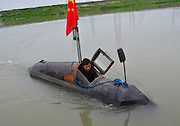MAANSHAN, CHINA - APRIL 27: (CHINA OUT) <br /> <br /> Homemade Submarine <br /> <br /> Zhang Shengwu gets into his homemade submarine in the river at Zhangdu village on April 27, 2016 in Maanshan, Anhui Province of China. 51-year-old Zhang Shengwu, who built a dock and sold building materials, used over 5,000 yuan (about 771 USD) make a submarine in two month in Maanshan. The 6-meter-long, 2 tons submarine was powered by a tricycle motor, and had no Oxygen supply system. The submarine could dove over one meter under water, and Zhang had obtained national patent for it on February in 2016<br /> ©Exclusivepix Media