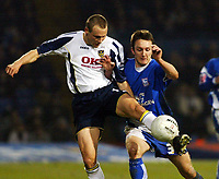Photo: Chris Ratcliffe.<br />Ipswich Town v Portsmouth. The FA Cup. 07/01/2006.<br />Matthew Taylor (L) of Portsmouth tussles with Gavin Williams.