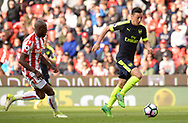 Mersut Ozil of Arsenal runs in and scores his teams 2nd goal. Premier league match, Stoke City v Arsenal at the Bet365 Stadium in Stoke on Trent, Staffs on Saturday 13th May 2017.<br /> pic by Bradley Collyer, Andrew Orchard sports photography.