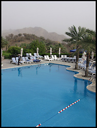 Empty sun loungers around a  Swimming pool in Hatta on the Oman UAE border near Dubai, UAE . Photo By Andrew Parsons/i-Images.