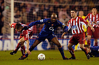 Photo. Jed Wee, Digitalsport<br /> Sheffield United v Arsenal, FA Cup 5th Round Replay, 01/03/2005.<br /> Arsenal's Patrick Vieira (C) stands strong against Sheffield's Leigh Bromby (L) and Nick Montgomery