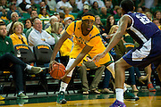 WACO, TX - JANUARY 11: Royce O'Neale #00 of the Baylor Bears brings the ball up court against the TCU Horned Frogs on January 11, 2014 at the Ferrell Center in Waco, Texas.  (Photo by Cooper Neill/Getty Images) *** Local Caption *** Royce O'Neale