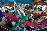 Riverboat passengers relax in a web of hammocks on the Solimoes River in Brazil. (From the book What I Eat: Around the World in 80 Diets.)