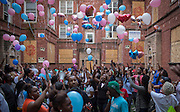 Family, friends and neighbors release balloons at the  apartment building where four children died in an overnight fire Monday, Sept. 8, 2014 at 11238 S. Vernon Ave. in Roseland.   (Brian Cassella/Chicago Tribune)