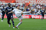 Swansea city's Chico Flores holds off West Ham's Carlton Cole. Barclays Premier league, Swansea city  v West Ham Utd at the Liberty Stadium in Swansea, South Wales  on Saturday 25th August 2012. pic by Andrew Orchard, Andrew Orchard sports photography,