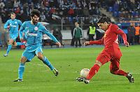 Thu., Feb. 14, 2013, Russia, St. Petersburg. .Zenit St. Petersburg's Netu, left, against Liverpool's Luis Suarez in the UEFA Europa League's last 32 match..Kommersant Photo/Alexander Petrosyan .