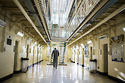 A prisoner walking towards the stairs on Benbow wing inside HMP/YOI Portland, a resettlement prison with a capacity for 530 prisoners. © prisonimage.org.  Any image use must be agreed first. All images must be credited.