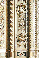 close up of Gothic bas-relief sculptures on the facade of  the Gothic-Renaissance Duomo of Florence,  Basilica of Saint Mary of the Flower; Firenza ( Basilica di Santa Maria del Fiore ).  Built between 1293 & 1436. Italy .<br /> <br /> Visit our ITALY PHOTO COLLECTION for more   photos of Italy to download or buy as prints https://funkystock.photoshelter.com/gallery-collection/2b-Pictures-Images-of-Italy-Photos-of-Italian-Historic-Landmark-Sites/C0000qxA2zGFjd_k<br /> .<br /> <br /> Visit our MEDIEVAL PHOTO COLLECTIONS for more   photos  to download or buy as prints https://funkystock.photoshelter.com/gallery-collection/Medieval-Middle-Ages-Historic-Places-Arcaeological-Sites-Pictures-Images-of/C0000B5ZA54_WD0s