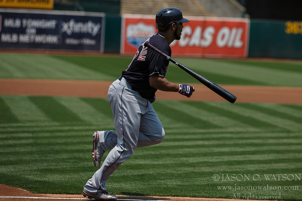 OAKLAND, CA - JULY 01:  Edwin Encarnacion #10 of the Cleveland Indians runs to first base after hitting an RBI single against the Oakland Athletics during the first inning at the Oakland Coliseum on July 1, 2018 in Oakland, California. The Cleveland Indians defeated the Oakland Athletics 15-3. (Photo by Jason O. Watson/Getty Images) *** Local Caption *** Edwin Encarnacion