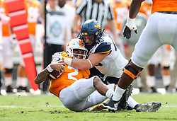 Sep 1, 2018; Charlotte, NC, USA; West Virginia Mountaineers defensive lineman Reese Donahue (46) tackles Tennessee Volunteers quarterback Jarrett Guarantano (2) during the first quarter at Bank of America Stadium. Mandatory Credit: Ben Queen-USA TODAY Sports