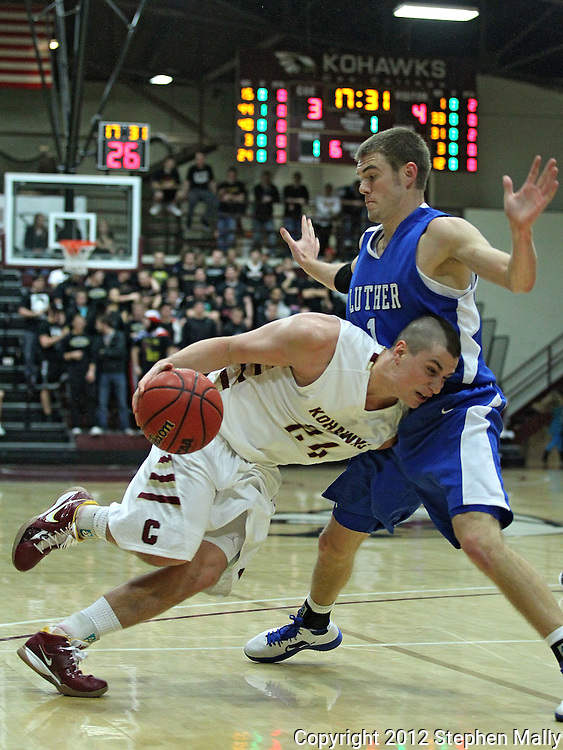 Coe's David Mataloni (24) drives into Lurther's Tim Merritt (1) during their Iowa Conference semifinal game at Eby Fieldhouse in Cedar Rapids on Thursday evening, February 23, 2012. Coe won 67-57. (Stephen Mally/Freelance)