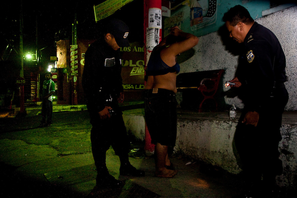 A police officer searches a man's body for tattoos early in the morning in San Salvador. Many Maras can't leave their house for fear of being thrown in jail . While this keeps Maras off the streets it also pushes Maras underground were they are more difficult to control and makes  assimilation into society impossible.